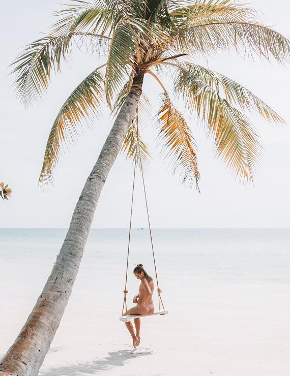 woman wearing bikini on a swing