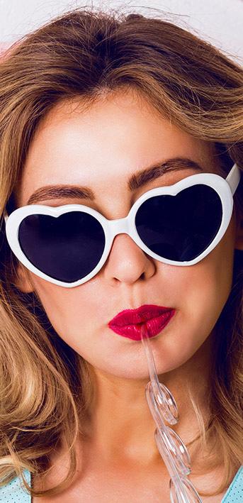 Woman wearing white heart-shaped glasses