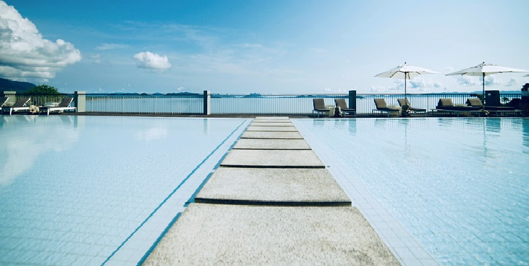walkway-though-a-clear-swimming-pool-near-the-ocean